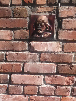 old tile in brick wall at luther burbank's home