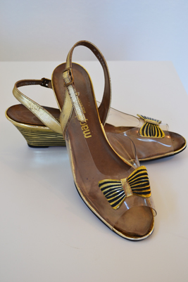 retro gold shoes with bow detail